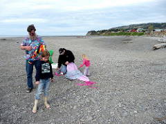 Assembling kites at the beach